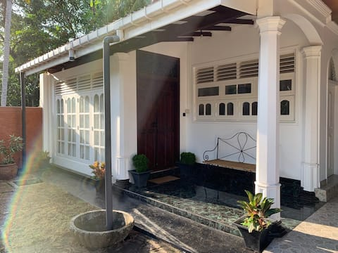 Tropical colonial retreat minutes from the beach
