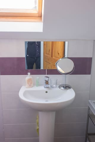 The attic bathroom is small but everything you need is there