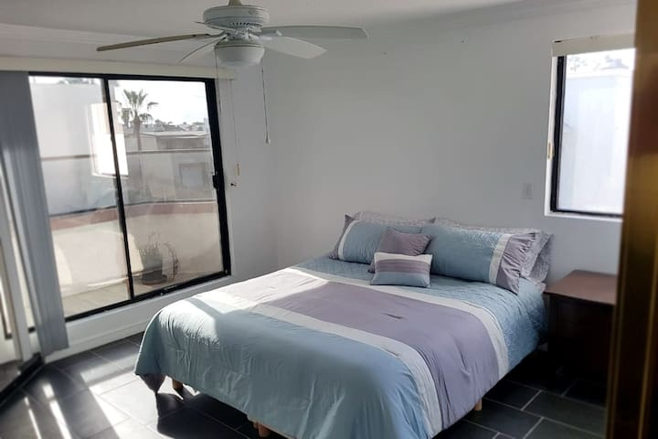 Master bedroom with private patio. King size bed and wood burning fireplace