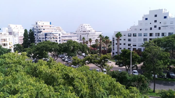 Quarteira Home with Ocean, Garden & Palm Views