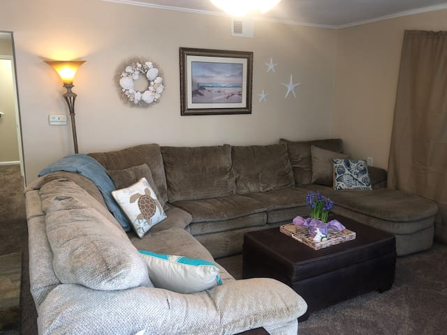 Large sectional with sofa bed, chaise and recliner can seat about 7-8 people.