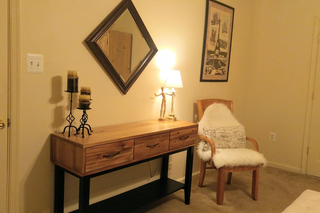 The bedroom dresser/console table, opposite the bed.