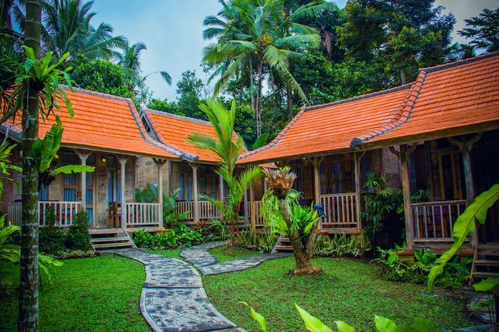 Deluxe Bale Kayu Room at De Umah Bali