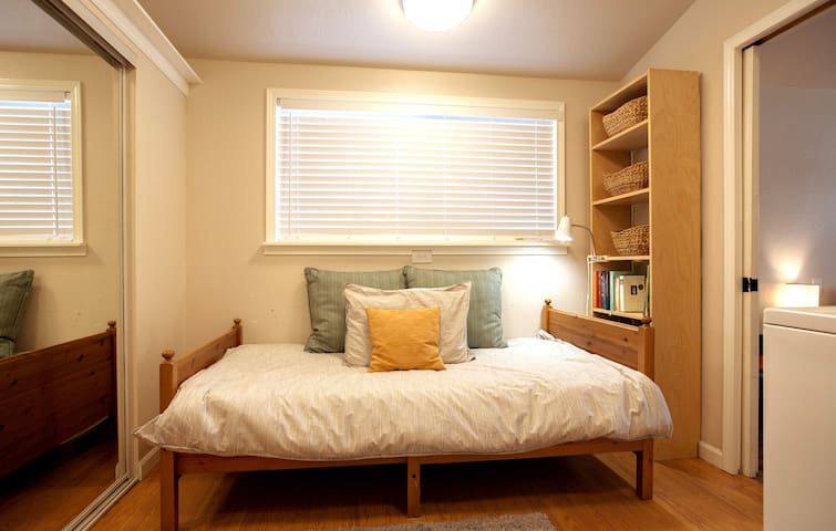 3rd bedroom located off master bedroom offers twin bed (shared space with washer/dryer)