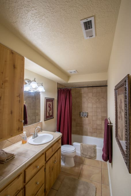 large bathroom that is in the room with 2 queen beds
