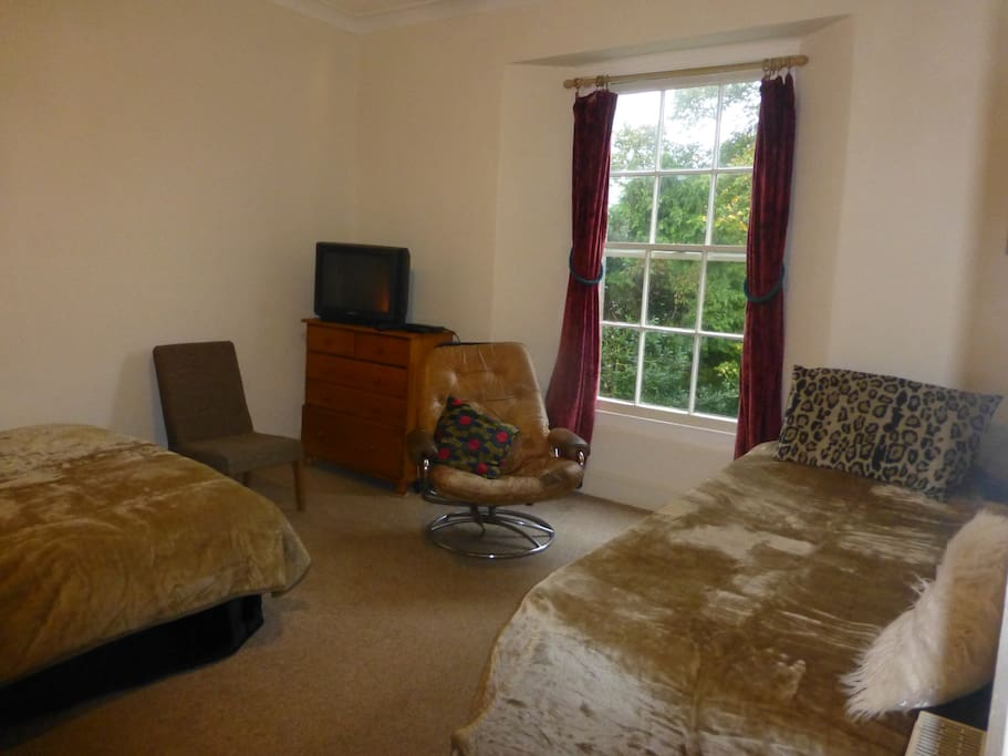 Double bedroom with extra single and TV.