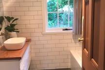 New bathrooms with bath and rain shower