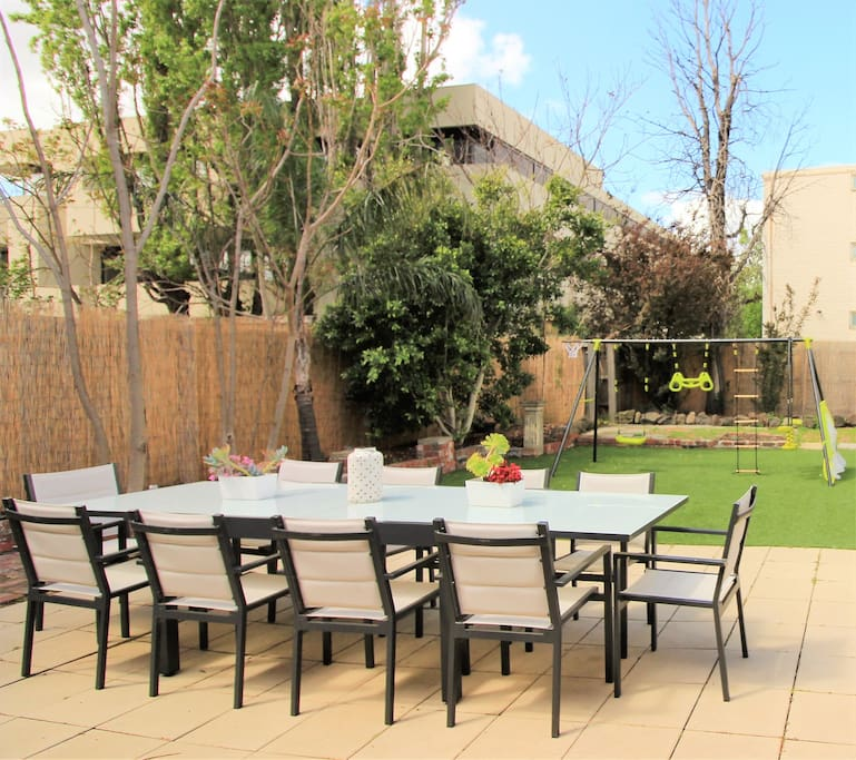 Huge garden with seating for 10, additional seat to sit and relax and a swing set for children.