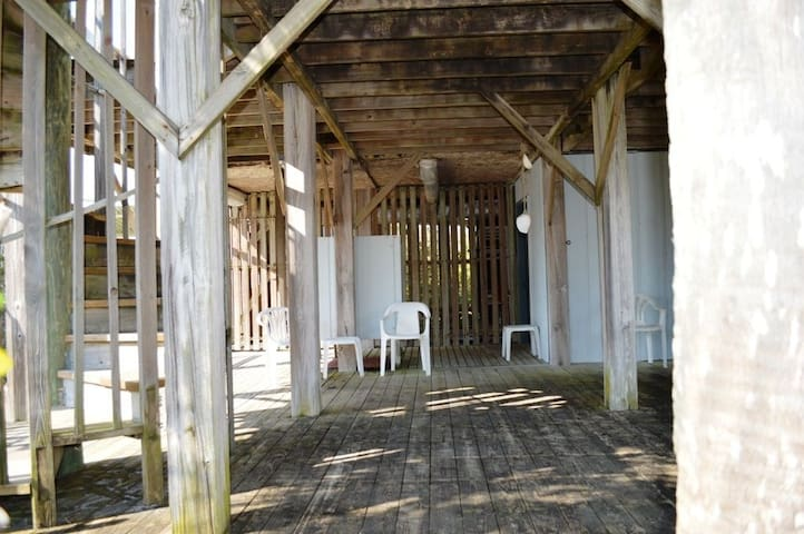 Lower Deck - What a great place to shower off the sand and salt water before taking it into the house with you.