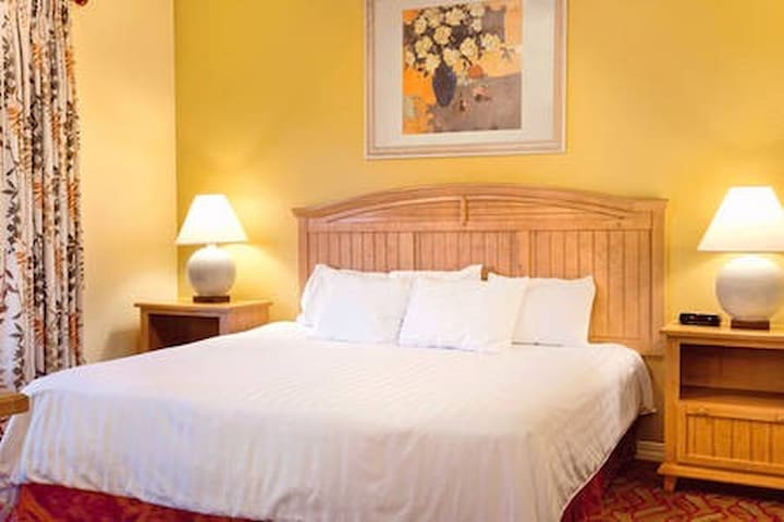A cozy king-sized bed in the master bedroom is sure to provide peaceful sleep