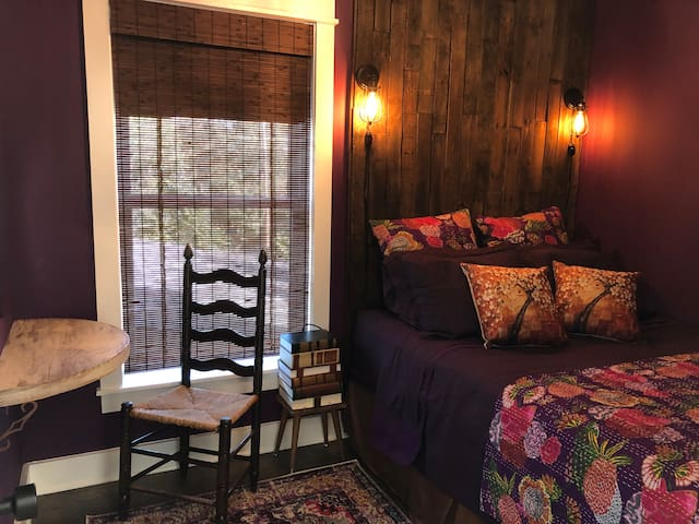 A favorite of many, this cozy purple room with floor to ceiling reclaimed  wood headboard, will carry you to dreamland! With a bed guests say is the most comfortable they have ever slept on, you will want to cuddle up after a long day of adventure!