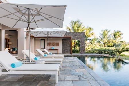 Chill in Hanging Nest Chairs at a Sumptuous Tropical Haven