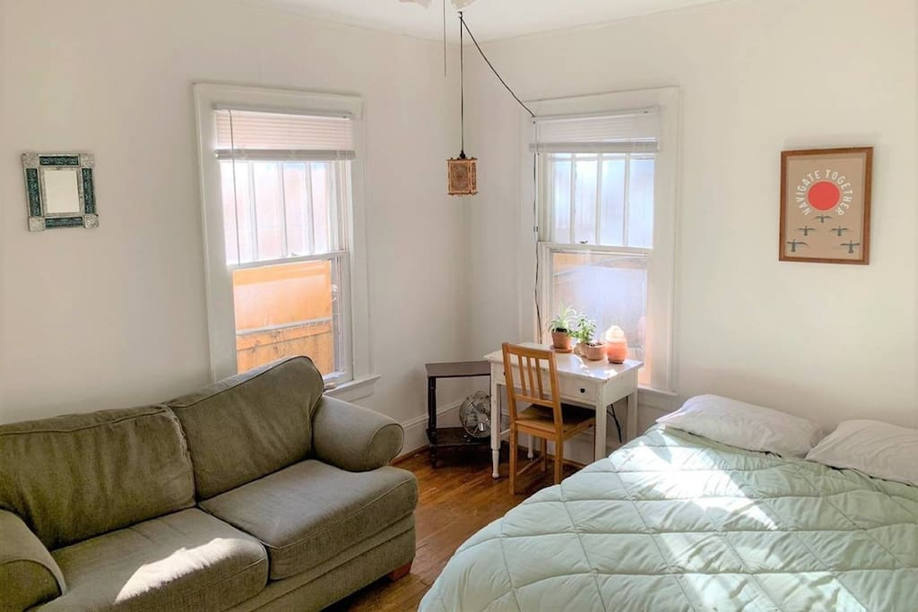 The second bedroom features a lovely queen bed, plush love seat, small writing desk, and nicely lit by overhead lanterns and salt lamps for a lovely mellow atmosphere.