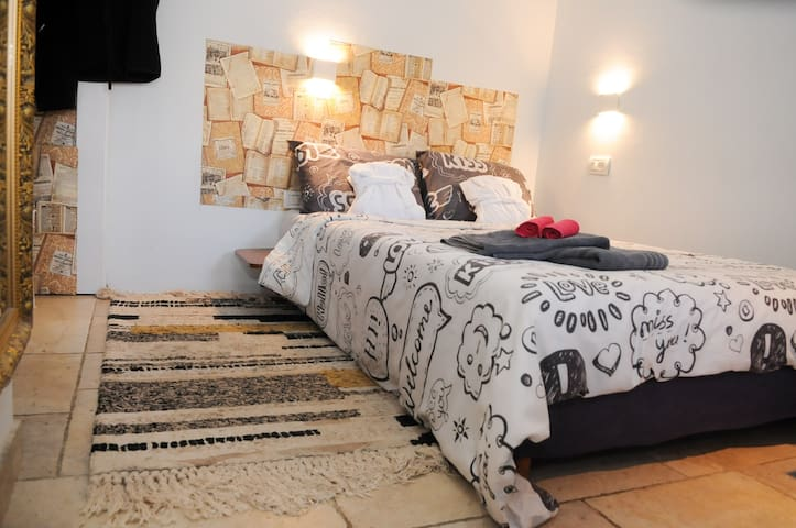 Room with Queen bed and Air conditioner