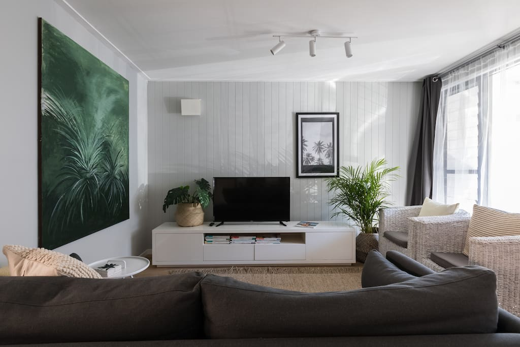 Cosy lounge room, soft cushions, beautiful afternoon sunlight and smart television.