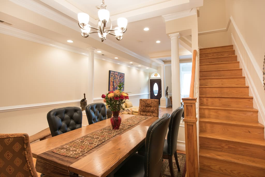 This is dinning room of home. Simply to receive you, this area of the house is off limits; showing first flight of stairs to get to your room.