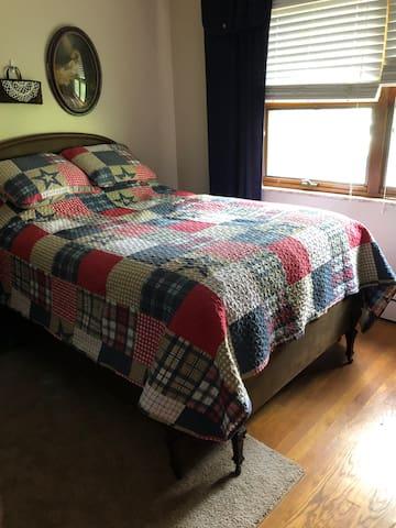 Second bedroom on main floor  Double bed.