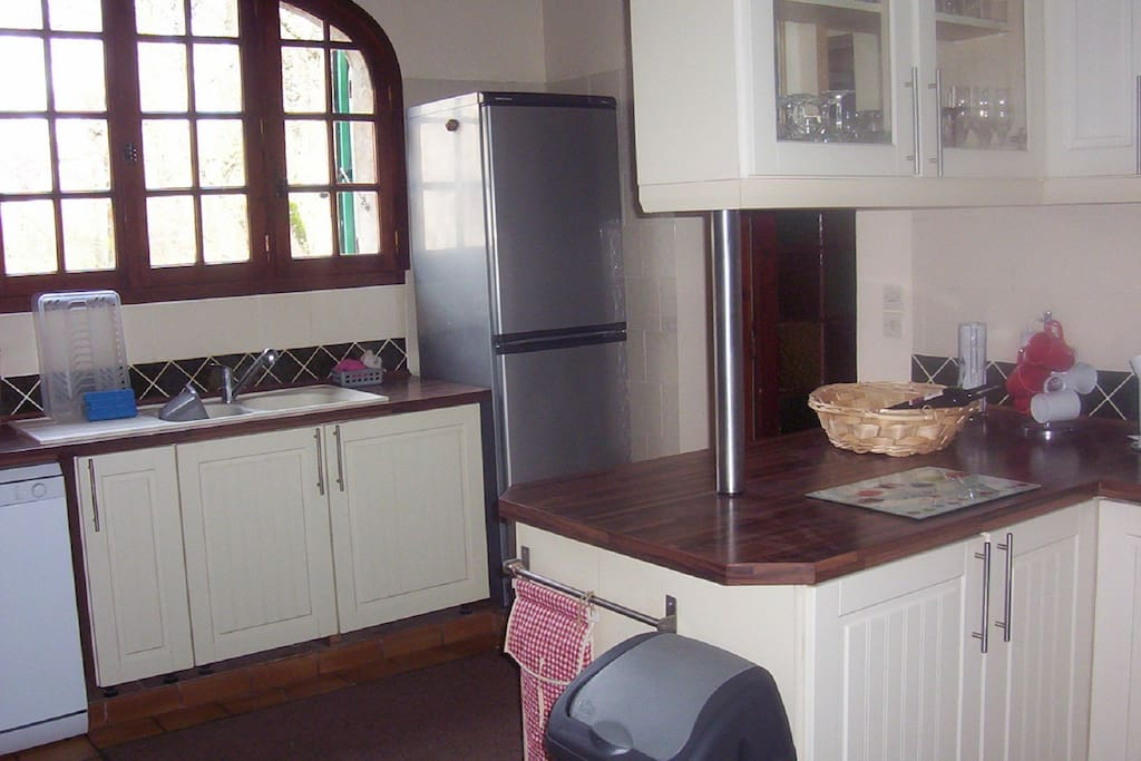 Well equipped kitchen overlooking the river
