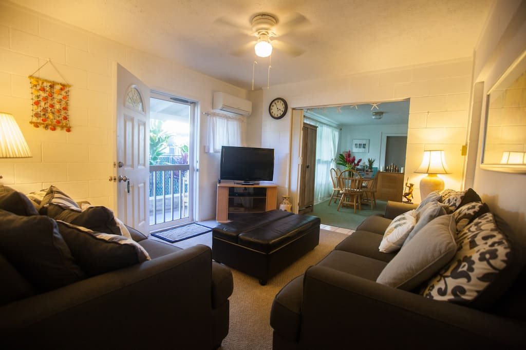 Comfortable living room with Cable TV and a selection of DVD movies.