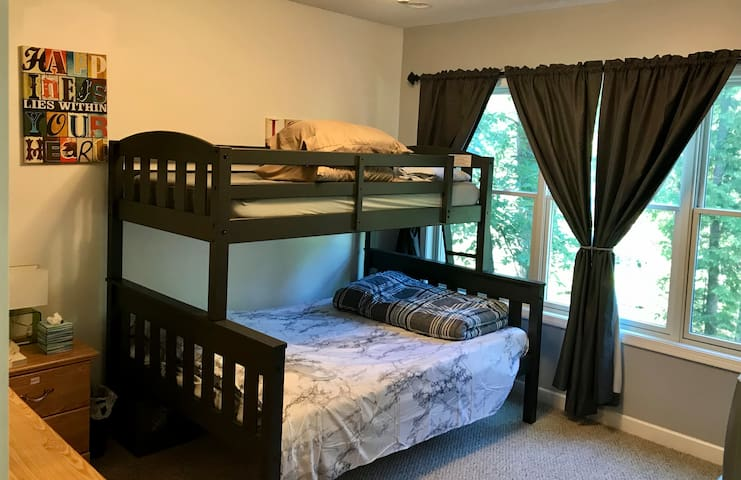 This is a 12x15 bedroom with a full size bed on the bottom and a twin on top with a river view.