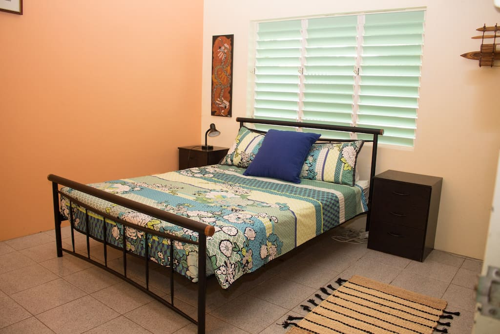 Queen bed in large bedroom.  Natural breezes or quiet split system air conditioning.