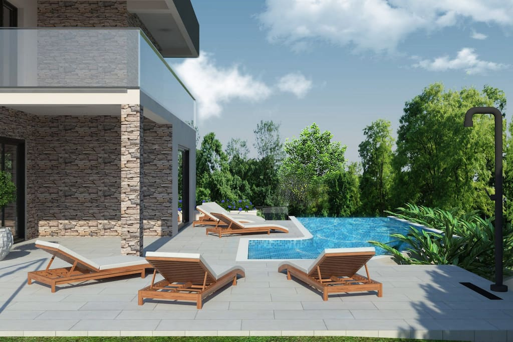 Pool area with sun deck and 6 sun loungers
