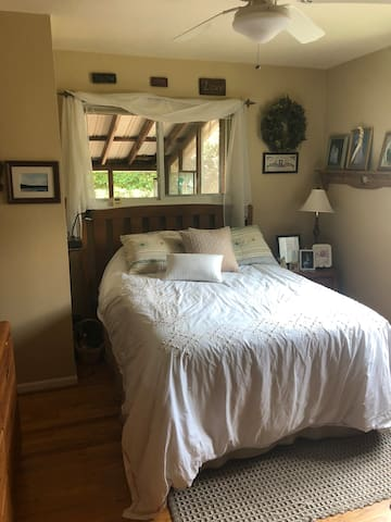 The master bedroom has an organic full size mattress and ensuite full bathroom with shower.