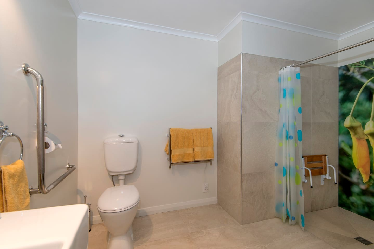 Kowhai's bathroom is setup to be accessible for those that are in a wheelchair.  The shower has a seat and the toilet is a raised style with hand rails.  The floor is still heated!.