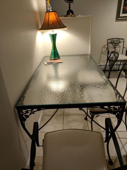 Spacious dining room table, can also be used as a workspace (has a table lamp)