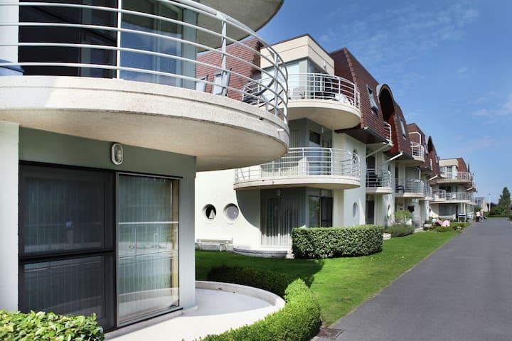 Modern Apartment with Swimming Pool near Sea in Bredene