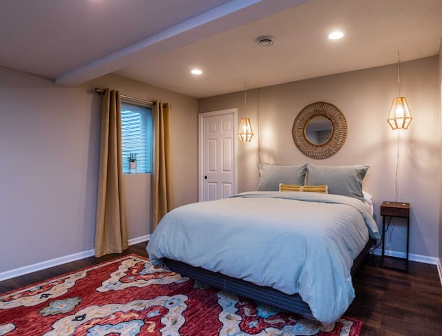 This is a queen size bed in the kitchen area. The pendant lamps are voice-controlled with Alexa. The nightstands are equipped with USB ports on the back.
