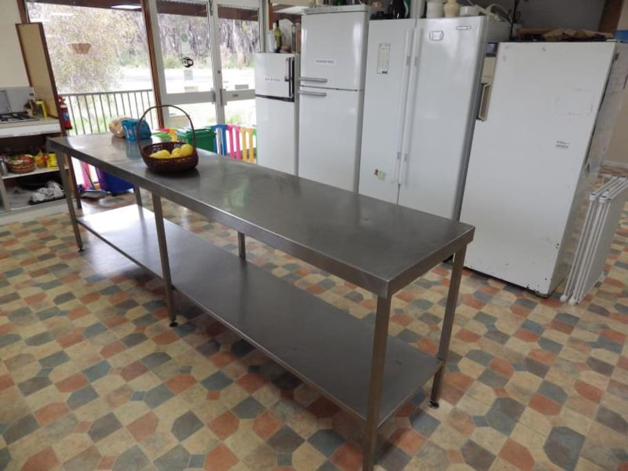Stainless steel prep area and communal fridges
