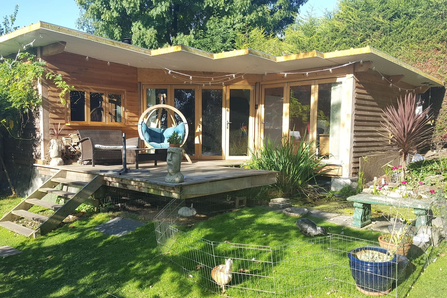 Completely self contained studio chalet at the top of our garden.  Fully insulated with underfloor heating, kitchen, wood burner,  fire basket and a view!
