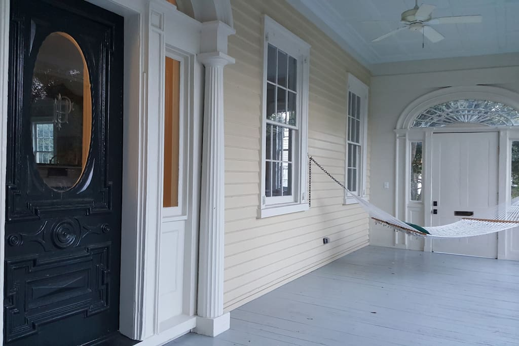Front door located on this huge beautiful porch with a hammock