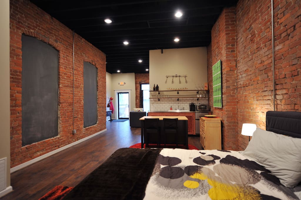 Open floor plan with exposed brick. Chalk boards outline destinations in the neighborhood worth checking out.