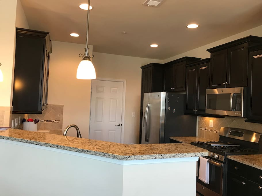 Fully furnished kitchen with granite counters