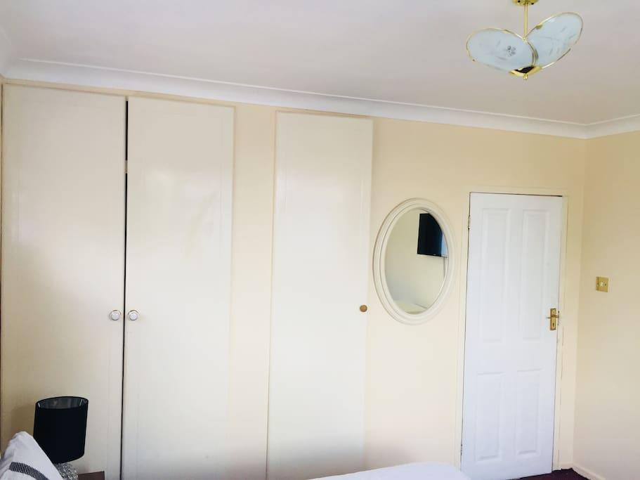 In built wardrobes & Mirror in your room