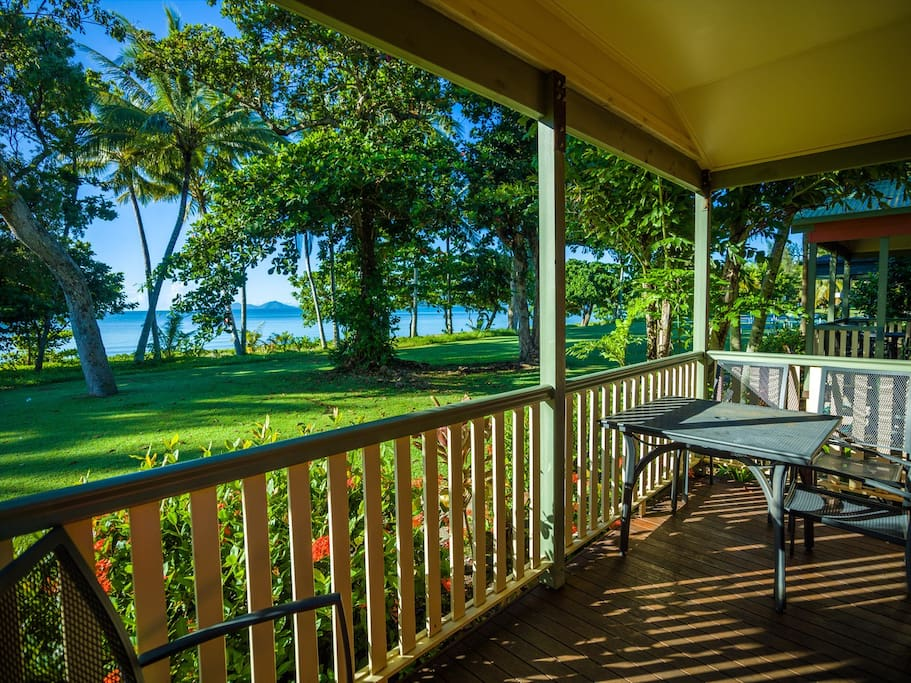 Enjoy a cold drink on your private deck overlooking the beach