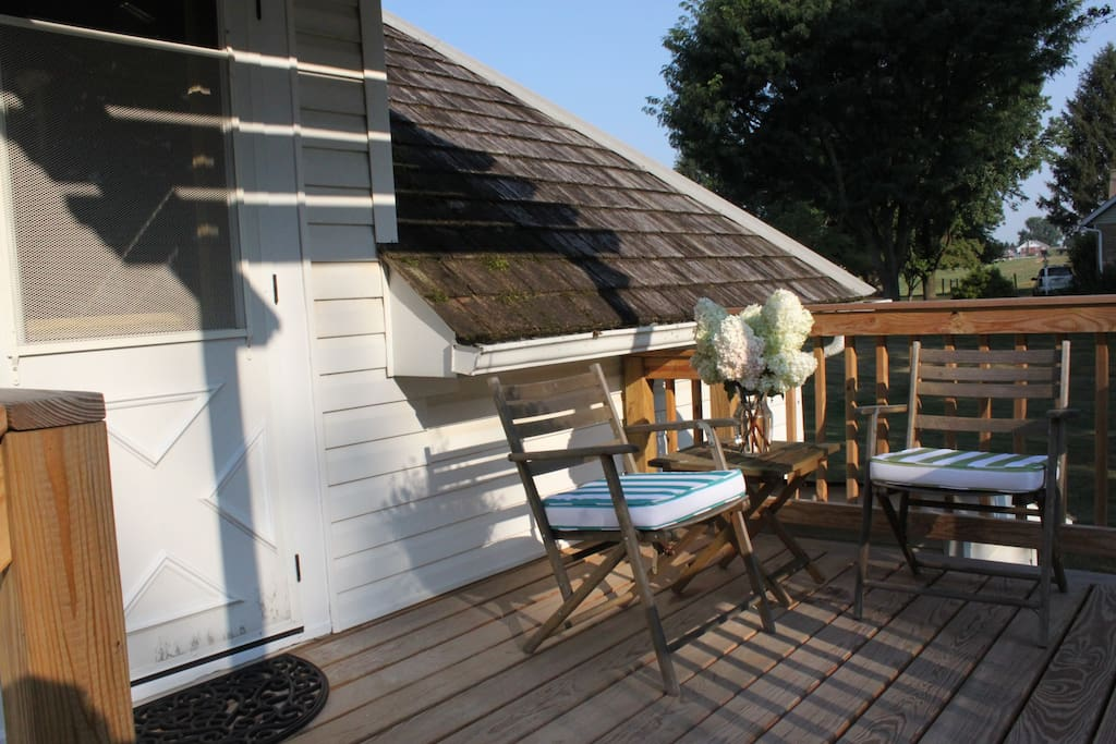 Your own private deck area with two chairs and side table