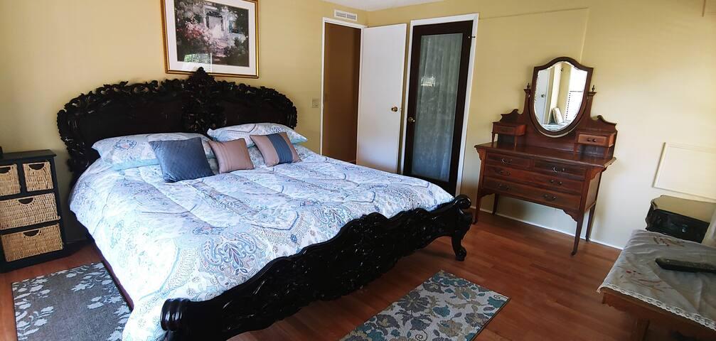 master bed with antique dresser