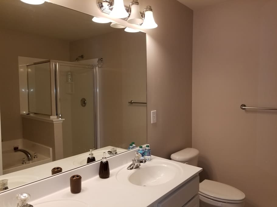 First bathroom with separate shower and tub, and double faucet.
