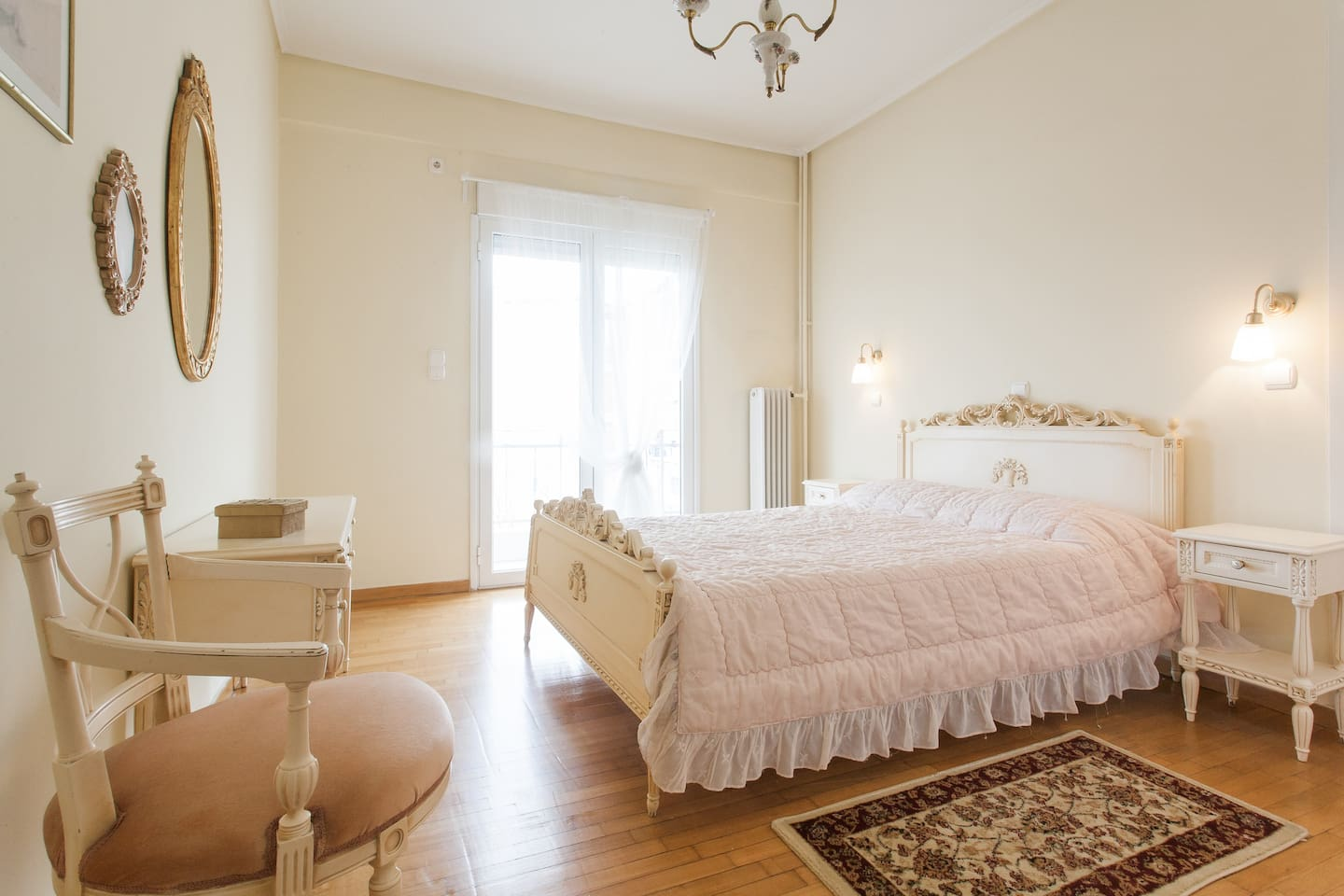 Sunny bedroom with comfortable bed