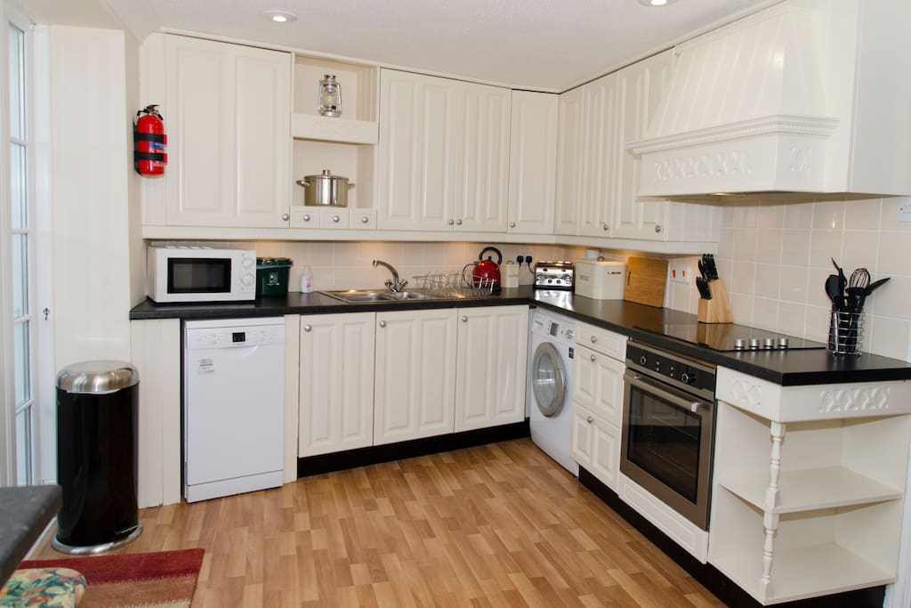 The good sized kitchen is well equipped with pots and pans a fan oven, ceramic hob,dishwasher and washing machine