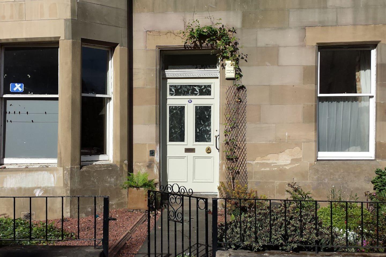 Ground floor access to traditional Edinburgh sandstone tenement