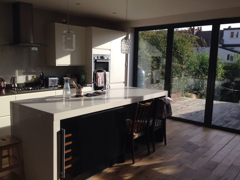Large open plan kitchen with double oven, gas hob, tumble dryer and washing machine.