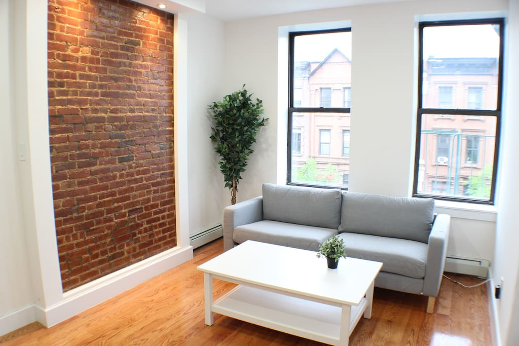 We have a pretty big living room with exposed brick for our guests