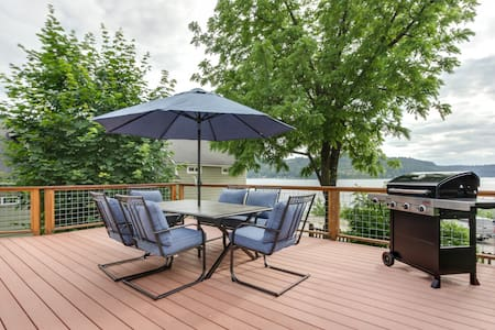 Dog-friendly getaway w/ a large deck & lake view - walk to shops & the marina