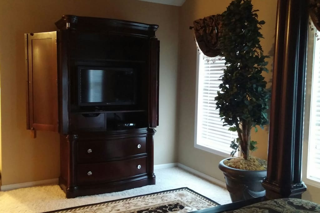 Armoire with tv and cable in master bedroom.