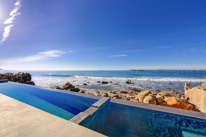 Your private pool is an architectural marvel that seems to flow into the sea.