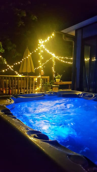 Hot Springs SIX person hot tub with water feature and adjustable colored lighting.